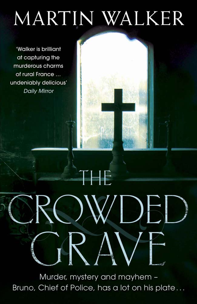 THE CROWDED GRAVE : A BRUNO COURREGES INVESTIGATION